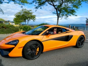 Grinning with boyish glee in a McLaren 570S